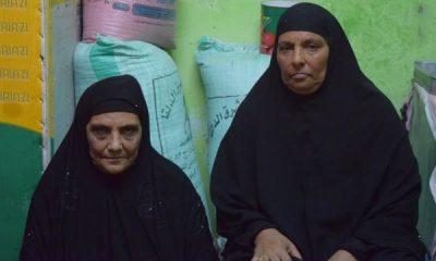 والدة العامل المصري عبد السلام صلاح الدنف وشقيقته- صورة لأصوات مصرية.