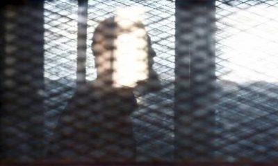 عادل حبارة داخل قفص الاتهام خلال جلسة محاكمة بالقاهرة- رويترز
